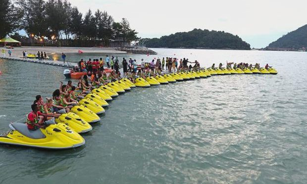 International pageant finalists on water scooters cause big splash in Langkawi